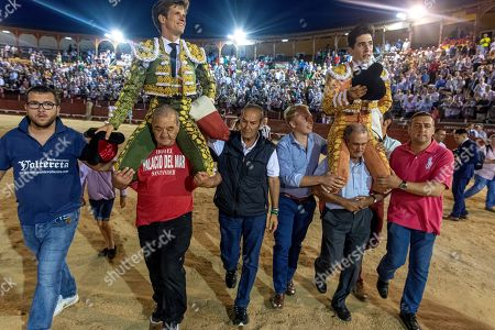 Spanish bullfighter Alvaro Lorenzo (R) and Julian Lopez 'El Juli' (L) go on shoulders out Toledo's Arena after cutting three ears each one during the Corpus Christi bullfighting held in Toledo, Spain, 20 June 2019.