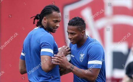 Ecuador's Antonio Valencia, right, and Arturo Mina talk during a training session in Salvador, Brazil, . Ecuador will face Chile for Copa America Group C soccer match