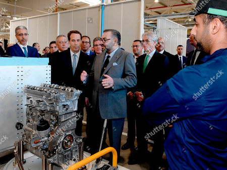 Mohammed VI, Jean-Christophe Quemard, Remi Cabon. In this photo provided by the Moroccan News Agency (MAP), Moroccan King Mohammed VI, second left, and Remi Cabon Director of the Kenitra PSA Group plant., second left, attend the inauguration of the French automaker PSA factory in Kenitra, north of Rabat, . The ceremony was marked by the unveiling of the new Peugeot 208, a vehicle produced in the Kenitra plant