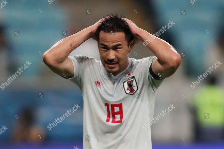 Japan's Shinji Okazaki reacts after missing a chance to score against Uruguay during a Copa America Group C soccer match at the Arena Gremio in Porto Alegre, Brazil