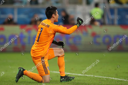 Japan's goalkeeper Eiji Kawashima celebrates after Japan's Koji Miyoshi scoring their side's second goal against Uruguay during a Copa America Group C soccer match at the Arena Gremio in Porto Alegre, Brazil