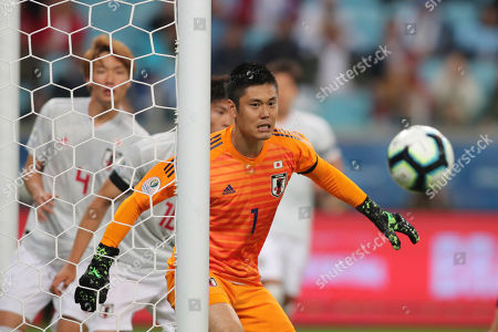Japan's goalkeeper Eiji Kawashima watches the ball during a Copa America Group C soccer match against Uruguay at the Arena Gremio in Porto Alegre, Brazil