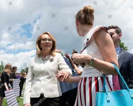 Stock Image of Former Congresswoman Gabrielle Giffords, of Arizona, departs a rally on Capitol Hill. The bill was passed in the House, but has been blocked by Republicans in the Senate.