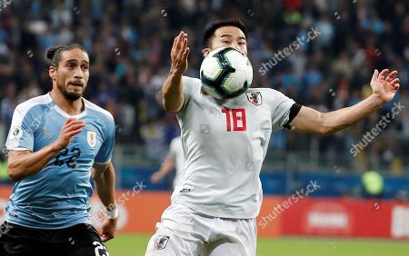 Martin Caceres (L) of Uruguay in action aginst Shinji Okazaki (R) of Japan during the Copa America 2019 Group C soccer match between Uruguay and Japan, at Arena do Gremio Stadium in Porto Alegre, Brazil, 20 June 2019.