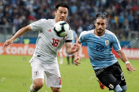 Martin Caceres (L) of Uruguay in action against Shinji Okazaki (R) of Japan during the Copa America 2019 Group C soccer match between Uruguay and Japan, at Arena do Gremio Stadium in Porto Alegre, Brazil, 20 June 2019.