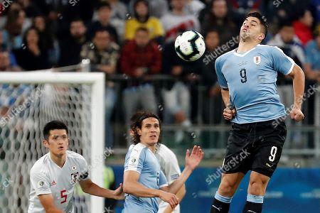 Luis Suarez (R) and Edinson Cavani (C) of Uruguay in action against Naomichi Ueda (L) of Japan during the Copa America 2019 Group C soccer match between Uruguay and Japan, at Arena do Gremio Stadium in Porto Alegre, Brazil, 20 June 2019.