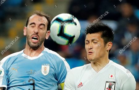 Diego Godin (L) of Uruguay in action against Naomichi Ueda (R) of Japan during the Copa America 2019 Group C soccer match between Uruguay and Japan, at Arena do Gremio Stadium in Porto Alegre, Brazil, 20 June 2019.