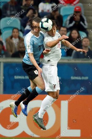 Uruguay's Diego Laxalt (L) vies for the ball against Japan's Tomoki Iwata during the Copa America 2019 Group C soccer match between Uruguay and Japan, at Arena do Gremio Stadium in Porto Alegre, Brazil, 20 June 2019.
