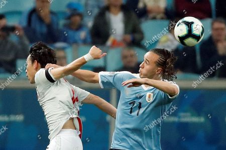 Uruguay's Diego Laxalt (R) vies for the ball against Japan's Koji Miyoshi during the Copa America 2019 Group C soccer match between Uruguay and Japan, at Arena do Gremio Stadium in Porto Alegre, Brazil, 20 June 2019.
