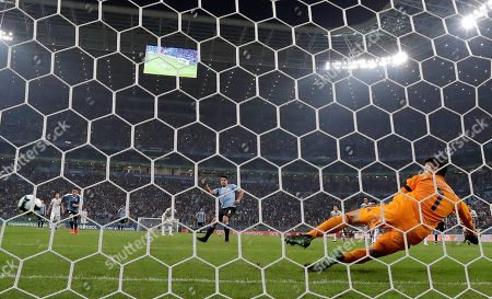 Japan's goalkeeper Eiji Kawashima (R) tries stop a goal attempt by Luis Suarez (C) of Uruguay during the Copa America 2019 Group C soccer match between Uruguay and Japan, at Arena do Gremio Stadium in Porto Alegre, Brazil, 20 June 2019.