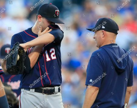 Jake Odorizzi, Wes Johnson. Minnesota Twins starting pitcher Jake Odorizzi (12) talks with pitching coach Wes Johnson during the first inning of the team's baseball game against the Kansas City Royals at Kauffman Stadium in Kansas City, Mo