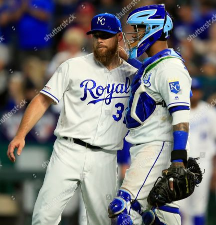 Ian Kennedy, Martin Maldonado. Kansas City Royals starting pitcher Ian Kennedy (31) and catcher Martin Maldonado, right, celebrate following the team's baseball game against the Minnesota Twins at Kauffman Stadium in Kansas City, Mo., . The Royals defeated the Twins 4-1