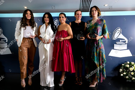 Mexican winners of Latin Recording Academy Leading Ladies of Entertainment awards pose with their Grammys during a red carpet event in Mexico City, . From left are singer Joy Huerta, radio host Martha Debayle, philanthropist Soumaya Slim Domit, architect Tatiana Bilbao and orchestra conductor Alondra de la Parra