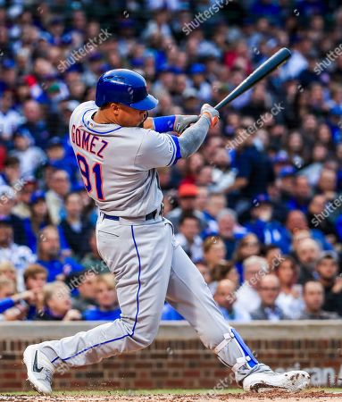 New York Mets center fielder Carlos Gomez hits into an RBI double play in the second inning of the MLB baseball game between the New York Mets and the Chicago Cubs at Wrigley Field in Chicago, Illinois, USA, 20 June 2019.