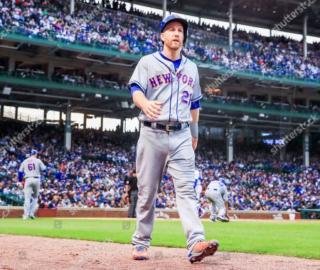 New York Mets third baseman Todd Frazier walks to the dugout after scoring on an RBI double play hit into by New York Mets center fielder Carlos Gomez in the second inning of the MLB baseball game between the New York Mets and the Chicago Cubs at Wrigley Field in Chicago, Illinois, USA, 20 June 2019.