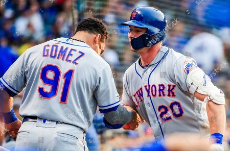 New York Mets first baseman Pete Alonso (R) celebrates with New York Mets center fielder Carlos Gomez (L) after hitting a two RBI home run in the third inning of the MLB game between the New York Mets and the Chicago Cubs at Wrigley Field in Chicago, Illinois, USA, 20 June 2019.
