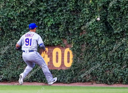 New York Mets center fielder Carlos Gomez chases a ball hit for a triple by Chicago Cubs shortstop Javier Baez in the third inning of the MLB game between the New York Mets and the Chicago Cubs at Wrigley Field in Chicago, Illinois, USA, 20 June 2019.