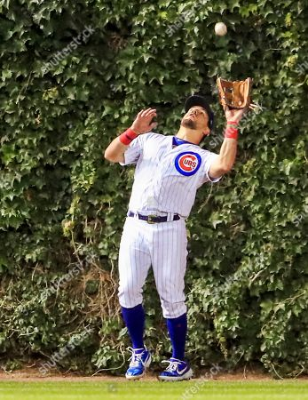 Chicago Cubs left fielder Kyle Schwarber catches a fly ball hit by New York Mets center fielder Carlos Gomez in the seventh inning of the MLB game between the New York Mets and the Chicago Cubs at Wrigley Field in Chicago, Illinois, USA, 20 June 2019.
