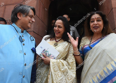 Congress MP Shashi Tharoor, BJP MP Hema Malini and BJP MP Kirron Kher after President Ram Nath Kovind addressed a joint session of Parliamen.