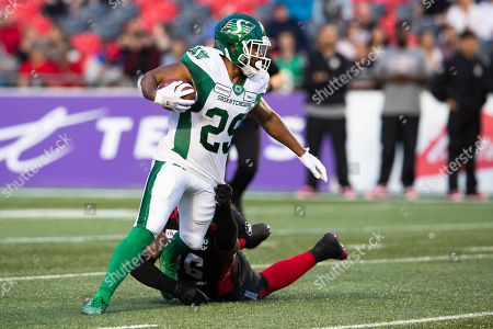 Saskatchewan Roughriders running back William Powell (29) escapes a tackle during the Canadian Football League game between the Saskatchewan Roughriders and Ottawa Redblacks at TD Place Stadium in Ottawa, Canada Daniel Lea/CSM