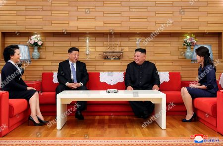 "Provided by the North Korean government, North Korean leader Kim Jong Un, center right, and his wife Ri Sol Ju, right, meet Chinese President Xi Jinping, center left, and his wife Peng Liyuan at Kumsusan guest house in Pyongyang, North Korea. The content of this image is as provided and cannot be independently verified. Korean language watermark on image as provided by source reads: ""KCNA"" which is the abbreviation for Korean Central News Agency"