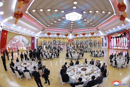 A photo released by the official North Korean Central News Agency (KCNA) shows Kim Jong Un, chairman of the Workers' Party of Korea and chairman of the State Affairs Commission of the Democratic People's Republic of Korea, and his wife Ri Sol Ju give a grand banquet on the evening of June 20 to welcome Xi Jinping, general secretary of the Central Committee of the Communist Party of China and president of the People's Republic of China, and his wife Peng Liyuan in Pyongyang, North Korea, 20 June 2019 (issued 21 June 2019). Xi Jinging is on a state visit to North Korea.