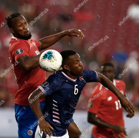 Stock Image of Kendall Waston (L) of Costa Rica in action against Jayton Bather (R) of Bermuda in the first half of the CONCACAF Gold Cup group stage soccer match between Costa Rica and Bermuda at the Toyota Stadium, in Frisco, USA, Texas, 20 June 2019.