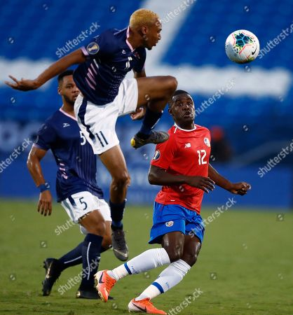 Joel Campbell (R) of Costa Rica in action against Willie Clemons (L) of Bermuda in the first half of the CONCACAF Gold Cup group stage soccer match between Costa Rica and Bermuda at the Toyota Stadium, in Frisco, USA, Texas, 20 June 2019.