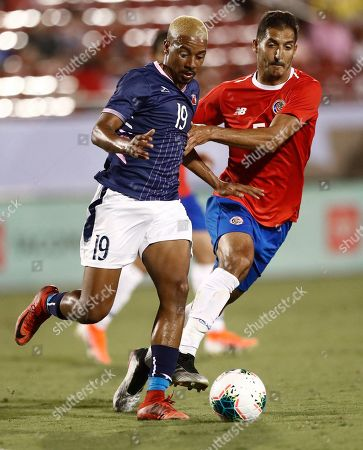 Celso Borges (R) of Costa Rica in action against Reginald Thompson-Iambe (L) of Bermuda in the second half of the CONCACAF Gold Cup group stage soccer match between Costa Rica and Bermuda at the Toyota Stadium, in Frisco, Texas, USA, 20 June 2019.