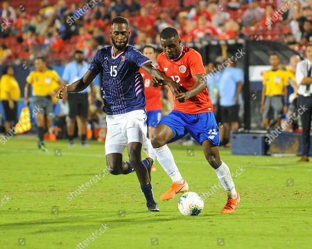 Costa Rica forward, Joel Campbell (12), moves the ball downfield as Bermuda midfielder, Milan Butterfield (15), tries to stop him, during CONCACAF Gold Cup match between Costa Rica and Bermuda, at Toyota Stadium in Frisco, TX. Costa Rica defeated Bermuda, 2-1. Mandatory Credit: Kevin Langley/Sports South Media/CSM