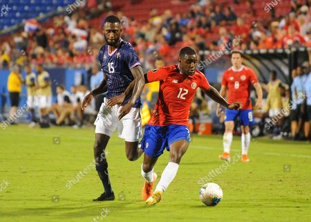 Costa Rica forward, Joel Campbell (12), moves the ball downfield as Bermuda midfielder, Milan Butterfield (15), follows him during CONCACAF Gold Cup match between Costa Rica and Bermuda, at Toyota Stadium in Frisco, TX. Costa Rica defeated Bermuda, 2-1. Mandatory Credit: Kevin Langley/Sports South Media/CSM