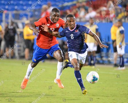 Bermuda midfielder, Donte Brangman (8), moves the ball downfield as Costa Rica forward, Joel Campbell (12), chases him during CONCACAF Gold Cup match between Costa Rica and Bermuda, at Toyota Stadium in Frisco, TX. Costa Rica defeated Bermuda, 2-1. Mandatory Credit: Kevin Langley/Sports South Media/CSM