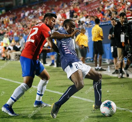 Costa Rica defender Ronald Matarrita (22) pushes on Bermuda midfielder Donte Brangman (8) during the second half of a CONCACAF Gold Cup soccer match in Frisco, Texas