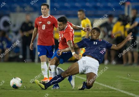 Bermuda defender Justin Donawa (17) steals the ball from Costa Rica defender Ronald Matarrita (22) during the second half of a CONCACAF Gold Cup soccer match in Frisco, Texas