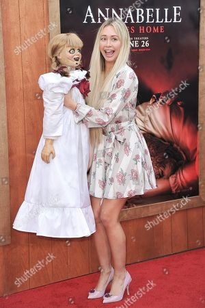 "Stock Image of Corinne Olympios attends the LA premiere of ""Annabelle Comes Home"" at the Regency Village Theatre, in Los Angeles"
