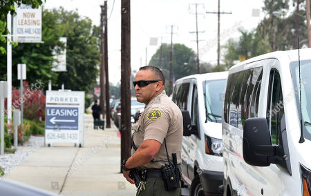 Stock Picture of Sheriff Ozuna stands next to the jury's vans as they visit an evidence site located at 4626 Arden Way in El Monte, during the murder trial of Michael Gargiulo in Los Angeles, California, USA, 20 June 2019. Gargiulo is charged in the stabbing deaths of two women, one of whom was about to go out with actor Ashton Kutcher that night, as well as attempting to kill a woman during a robbery at her Santa Monica home.