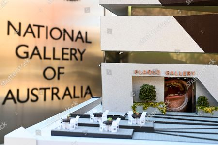 Stock Picture of Miniature artwork by artists Damien Hirst, Jeff Koons, Jasper Johns, David Choe and Anish Kapoor is seen attached to the teeth of a member of the Plaque Gallery during the first showing of the smallest functional gallery outside the National Gallery of Australia in Canberra, Australia, 21 June 2019. After this opening in Australia, Plaque Gallery is set to travel the world, leaving on Sunday for New York, London, Paris, Berlin then Tokyo.