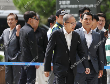 Stock Picture of South Korean Former President Lee Myung-bak (C) arrives at the Seoul High Court in Seoul, South Korea, 21 June 2019, to attend a hearing. Lee, who was released on bail from a detention center on 06 March, is appealing a 15-year sentence for bribery, embezzlement and other acts of corruption.