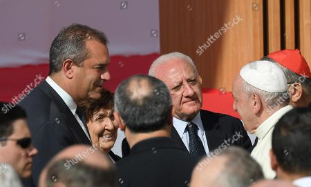 Pope Francis (R) is welcomed by Campania Governor Vincenzo De Luca (C) and Naples Mayor Luigi de Magistris (L) upon his arrival at the Theological Faculty of Southern Italy, in Naples, southern Italy, 21 June 2019. Pope Francis is on a one-day visit to the southern Italian city of Naples to take part in a conference that will discuss the impact of the Apostolic Constitution, Veritatis Gaudium, on theological studies.