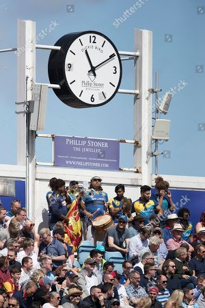 A group of Sri Lankan fans with instruments under the Dickie Bird clock during England vs Sri Lanka, ICC World Cup Cricket at Headingley Cricket Ground on 21st June 2019
