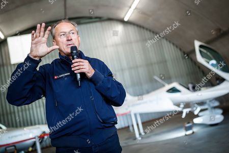 Andre Borschberg, chairman of H55, presents H55?s electric flight trainer (background), a fully electric powered two-seater propulsion airplane, during a press conference in Sion, Switzerland, 21 June 2019. The technology used in the aircraft is derived from the 'Solar Impulse' airplanes, the first electric powered planes of which the 'Solar Impulse 2' (HB-SIB), co-piloted by Borschberg and Swiss psychiatrist, balloonist and adventurer Bertrand Piccard, successfully circumnavigated the world in 2016.