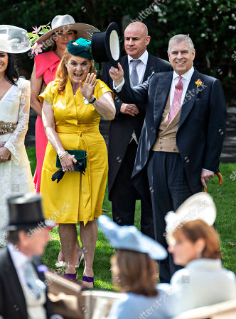 Stock Picture of Sarah Ferguson Duchess of York joins Prince Andrew to wave to the to John Warren and his wife Lady Carolyn Warren as they arrive