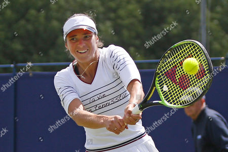 Bibiane Schoofs of Holland plays a backhand during the Women's Singles Quarter Final at the Fuzion 100 Ilkley Lawn Tennis Trophy Tournament held at Ilkley Lawn Tennis and Squad Club, Ilkley
