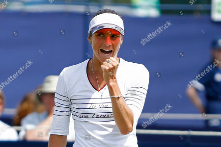 Stock Photo of Bibiane Schoofs of Holland celebrates taking the second set of the Women's Singles Quarter Final on a tie break at the Fuzion 100 Ilkley Lawn Tennis Trophy Tournament held at Ilkley Lawn Tennis and Squad Club, Ilkley