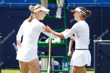 Stock Picture of Anna Blinkova of Russia and Bibiane Schoofs of Holland embrace after Schools' victory in the Women's Singles Quarter Final during the Fuzion 100 Ilkley Lawn Tennis Trophy Tournament held at Ilkley Lawn Tennis and Squad Club, Ilkley