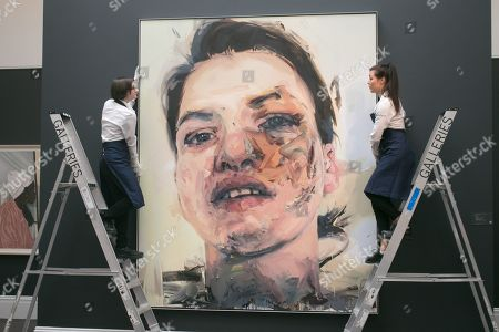 Sotheby's technicians with a Shadow Head, 2007-2013 by Jenny Saville, Oil on Canvas. Estimate: £3,000,000-5,000,000