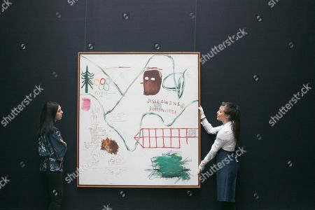 Sotheby's technicians with Big Snow, 1984, Acrylic and oilstick on canvas by Jean-Michel Basquiat. Estimate: £3,500,000-4,500,000