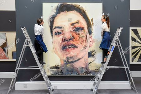 Stock Picture of Technicians inspect 'Shadow Head', 2007-2013, by Jenny Saville at the preview of a Contemporary Art auction at Sotheby's New Bond Street