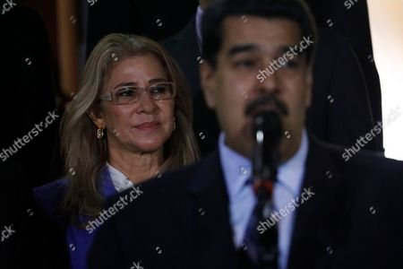 Michelle Bachelet, Nicolas Maduro. With first lady Cilia Flores in the background, Venezuela's President Nicolas Maduro speaks to the press after a meeting with U.N. High Commissioner for Human Rights Michelle Bachelet at Miraflores Presidential Palace, in Caracas, Venezuela, . The United Nations' top human rights official is visiting Venezuela amid heightened international pressure on President Maduro