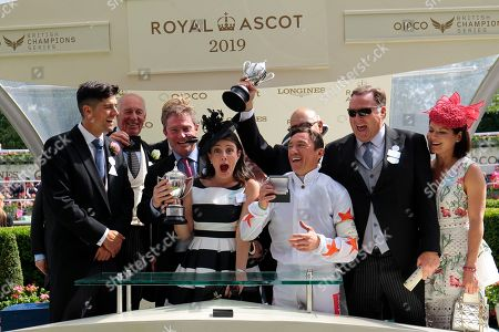 Stock Photo of Sir Alistair Cook presents to an excited Frankie Dettori after Advertise had won the Commonwealth Cup at Royal Ascot.